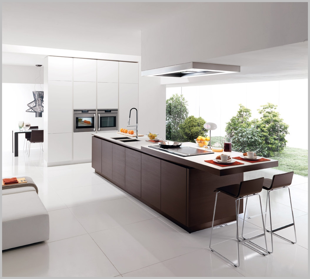 Minimalist kitchen with wooden island and solid surface top